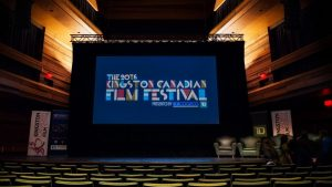 Kingston Canadian Film Festival 2016 logo projected on a screen in the performance hall at the Isabel Bader Centre