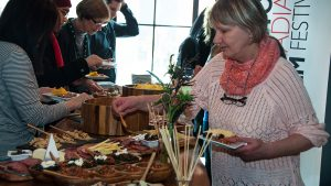 Festival patrons enjoying some delicious food at a reception