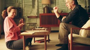 A still image of Sigourney Weaver and Alan Rickman playing Scrabble